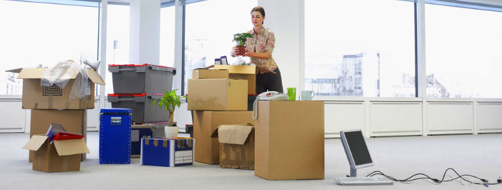 Woman with the boxes in the office