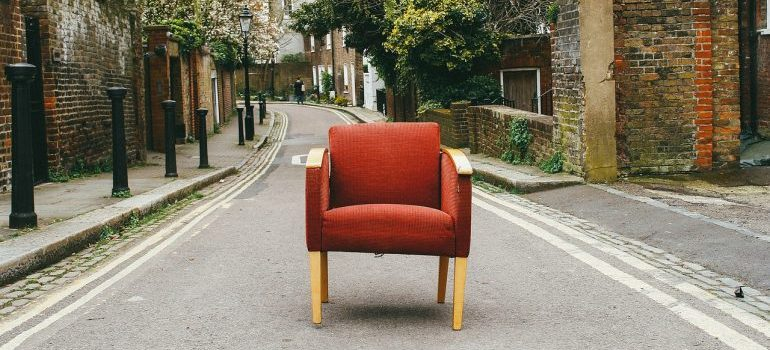 A red chair to leave behind and boost your relocation budget.