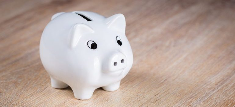 A white piggy bank - the hidden costs of moving lie in hiring cheap movers