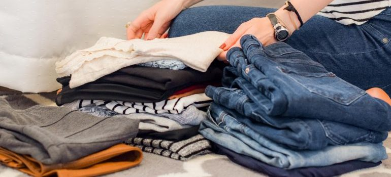 A woman folding clothes