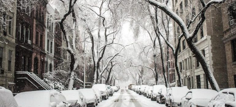 Snowy streets like this one make winter the cheapest time to relocate
