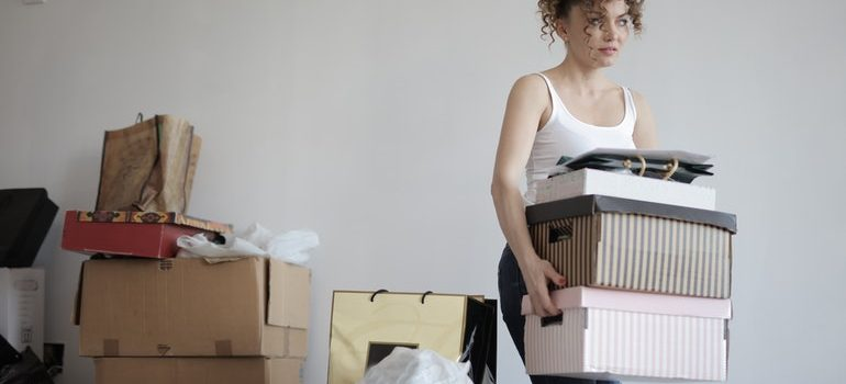 Woman carrying boxes.
