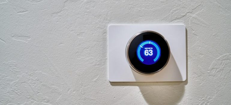 A white thermostat- a benefit of short term storage rental is that they are climate-controlled