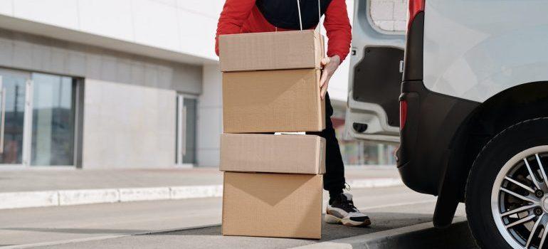 Man stacking cardboard boxes