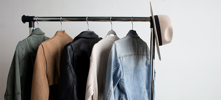 Light jackets and a hat on a clothing rack