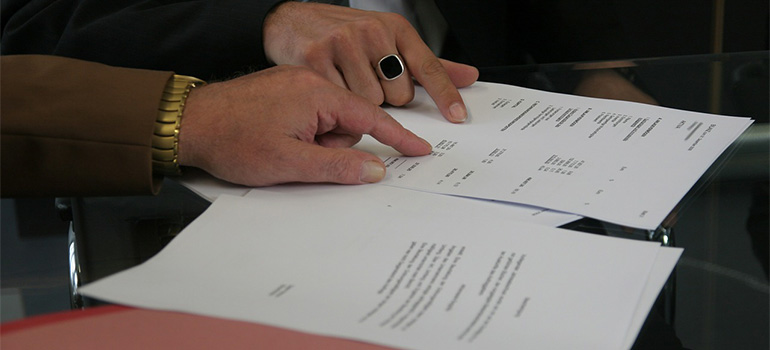 Two people going over a contract