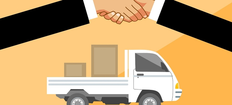 Shaking hand in front of a truck