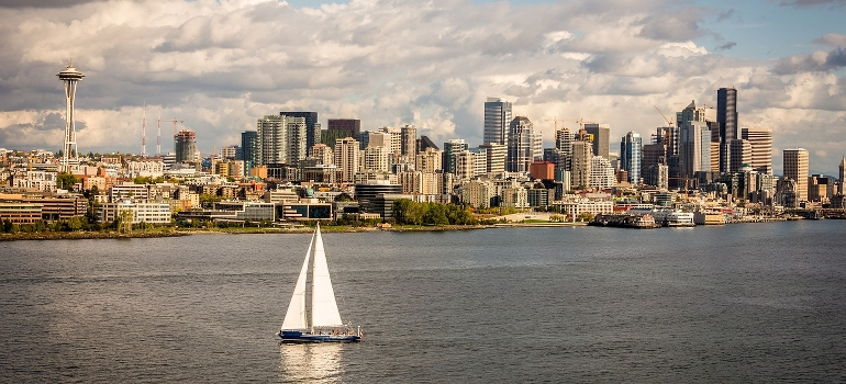 A boat floating in front of Seattle