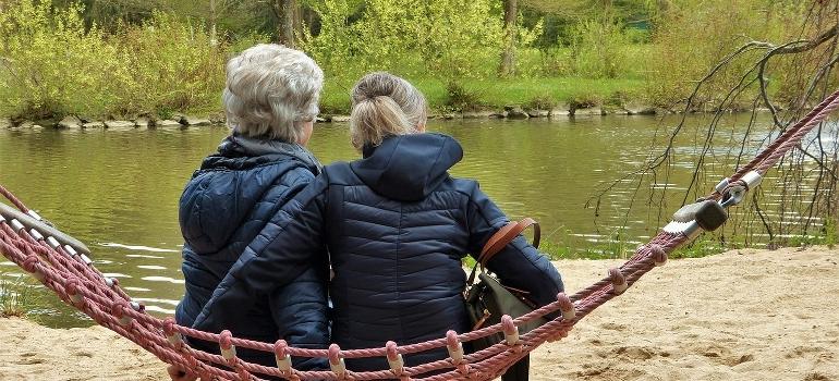 Two women sitting in a hammock