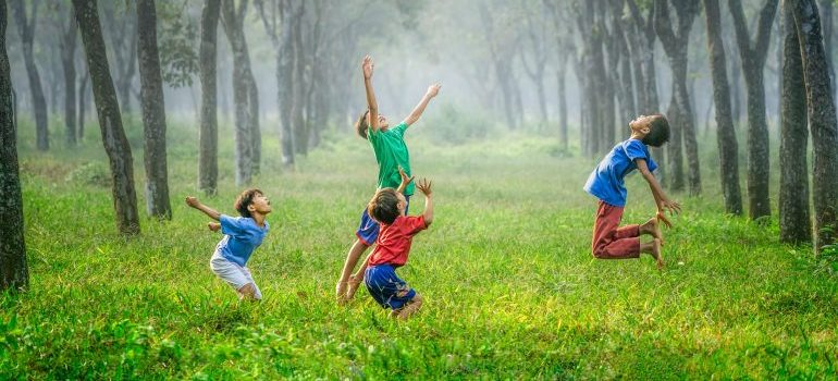 four kids playing in a park