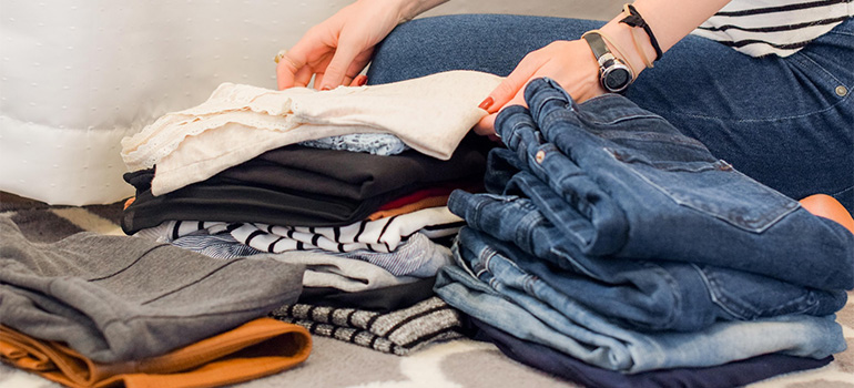 A woman sorting her clothing items