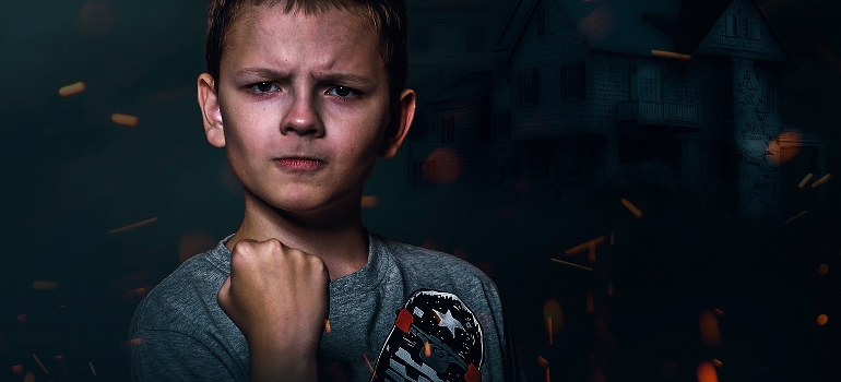 an angry teenager showing his fist