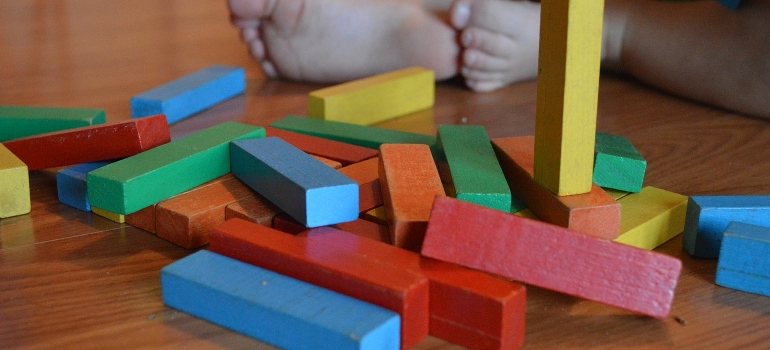 a pile of colorful wooden toys