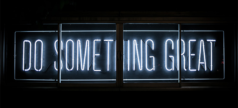 A neon sigh saying ''do something great''
