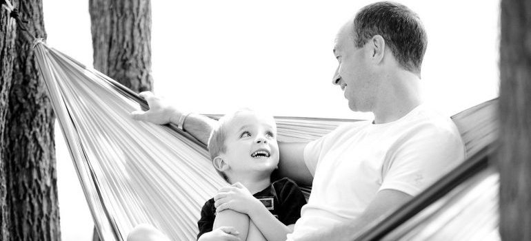 A black and white photo of a boy and his father.
