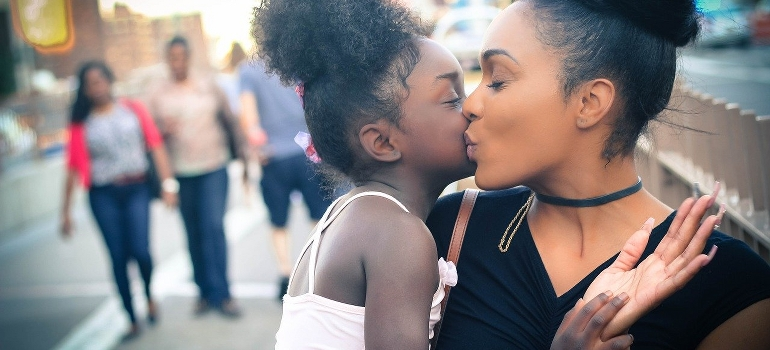 A mom and a daughter hugging on the street of Renton WA