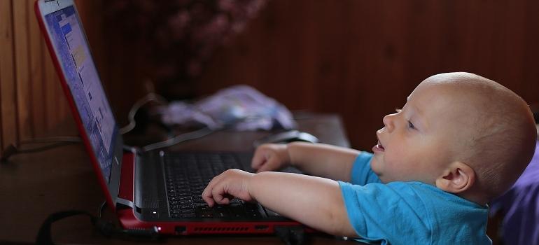 A toddler using a computer