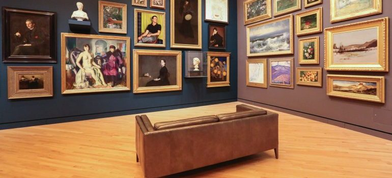art gallery with a couch in the middle