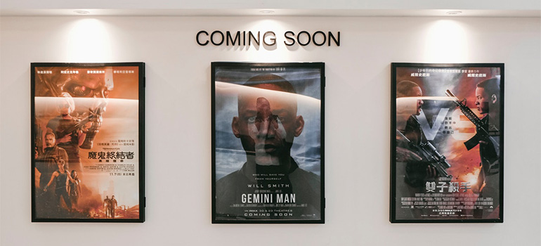 Movie posters in a cinema