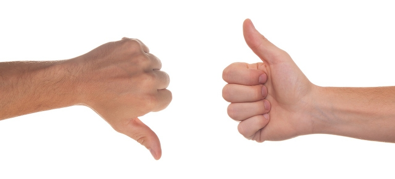 two hands showing thumbs up and down