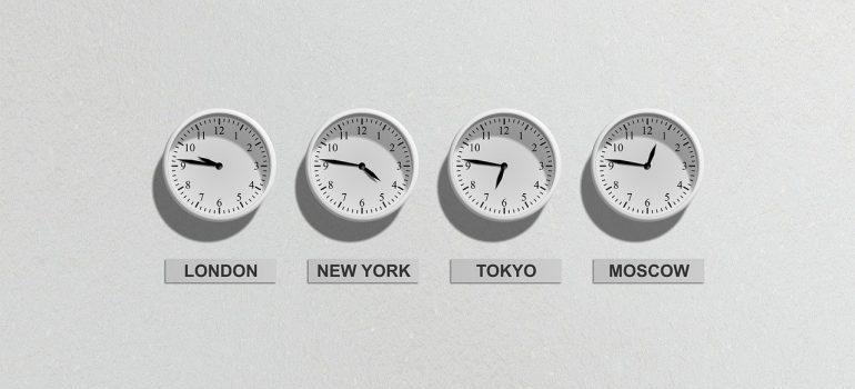 Four alarm clocks on the wall.