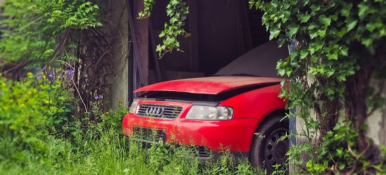 an abandoned car in a garage