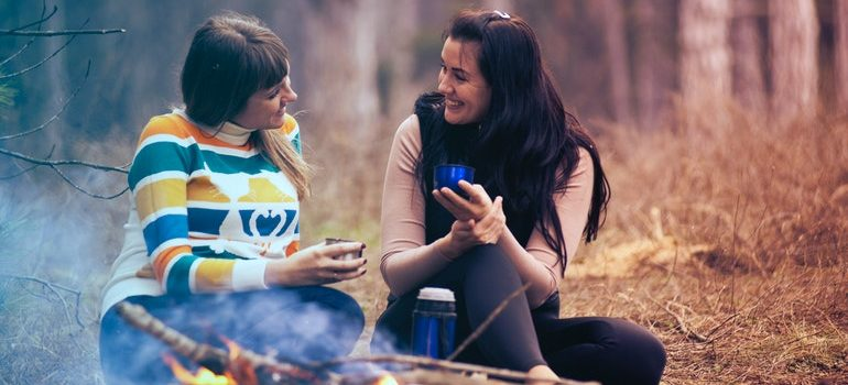 Two girls having a picnic.