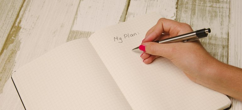 A person writing in notebook