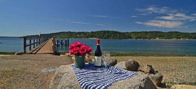 Roses and a bottle of wine on a beach of Bainbridge Island