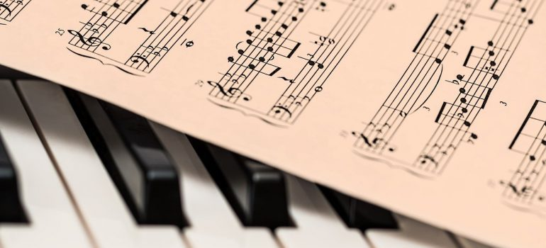 A sheet of music on a piano.