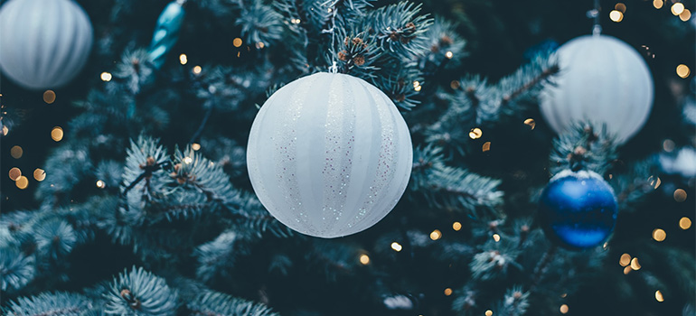 A Christmas tree with white ornaments