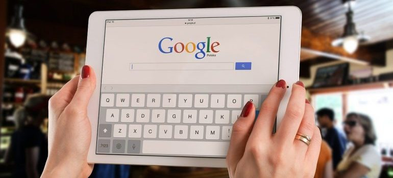 A woman using Google to find a good storage facility.