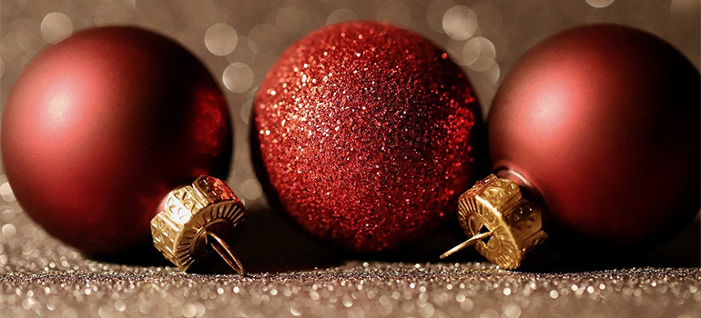 Three red Christmas tree ornaments