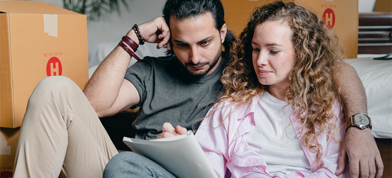 A couple sitting down to create a moving inventory list