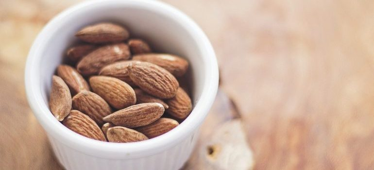 A cup full of almonds.