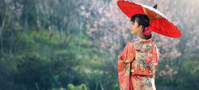 A girl wearing a traditional Japanese attire.