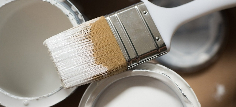 pain brush and paint cans