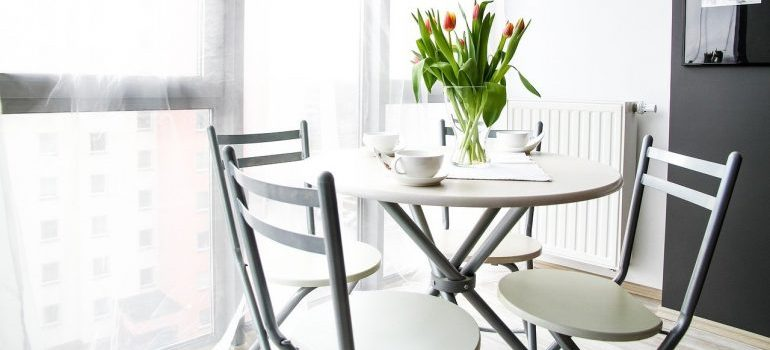 A dining room as a result of combining two homes into one when moving.
