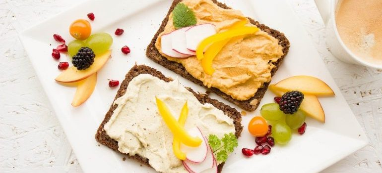 Hummus spread on bread and some fruit.