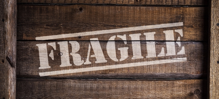 wooden crate with fragile sign on it