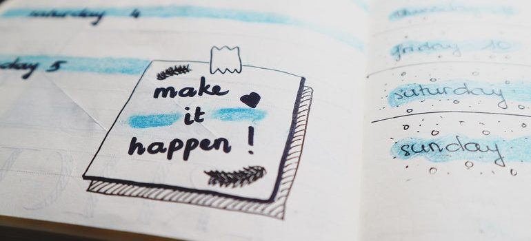 "Weekly planner with a note saying ""make it happen""."