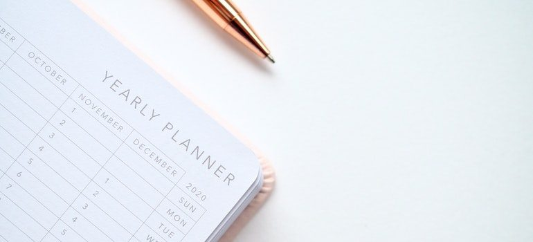 Yearly planner and pen.