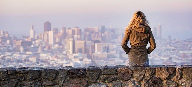 A woman looking at the city from a distance after moving to San Francisco.
