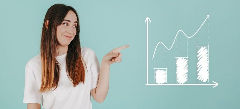 A woman pointing to a chart.