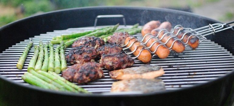Grilling meat and vegetables.