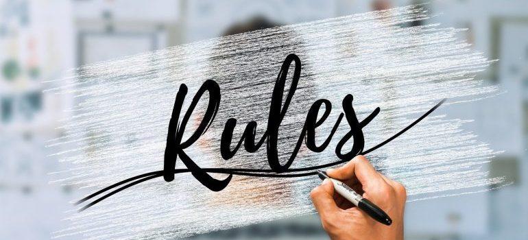 The word rules written in a black pen.