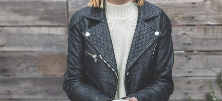 A woman in a leather jacket.