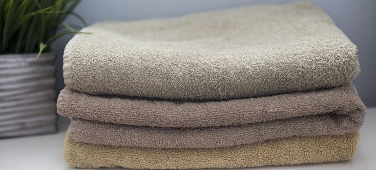 A stack of towels to use as sustainable moving ideas and solutions.