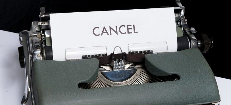 A paper with the word cancel coming out of a typewriter.