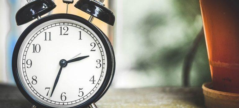 A black alarm clock.